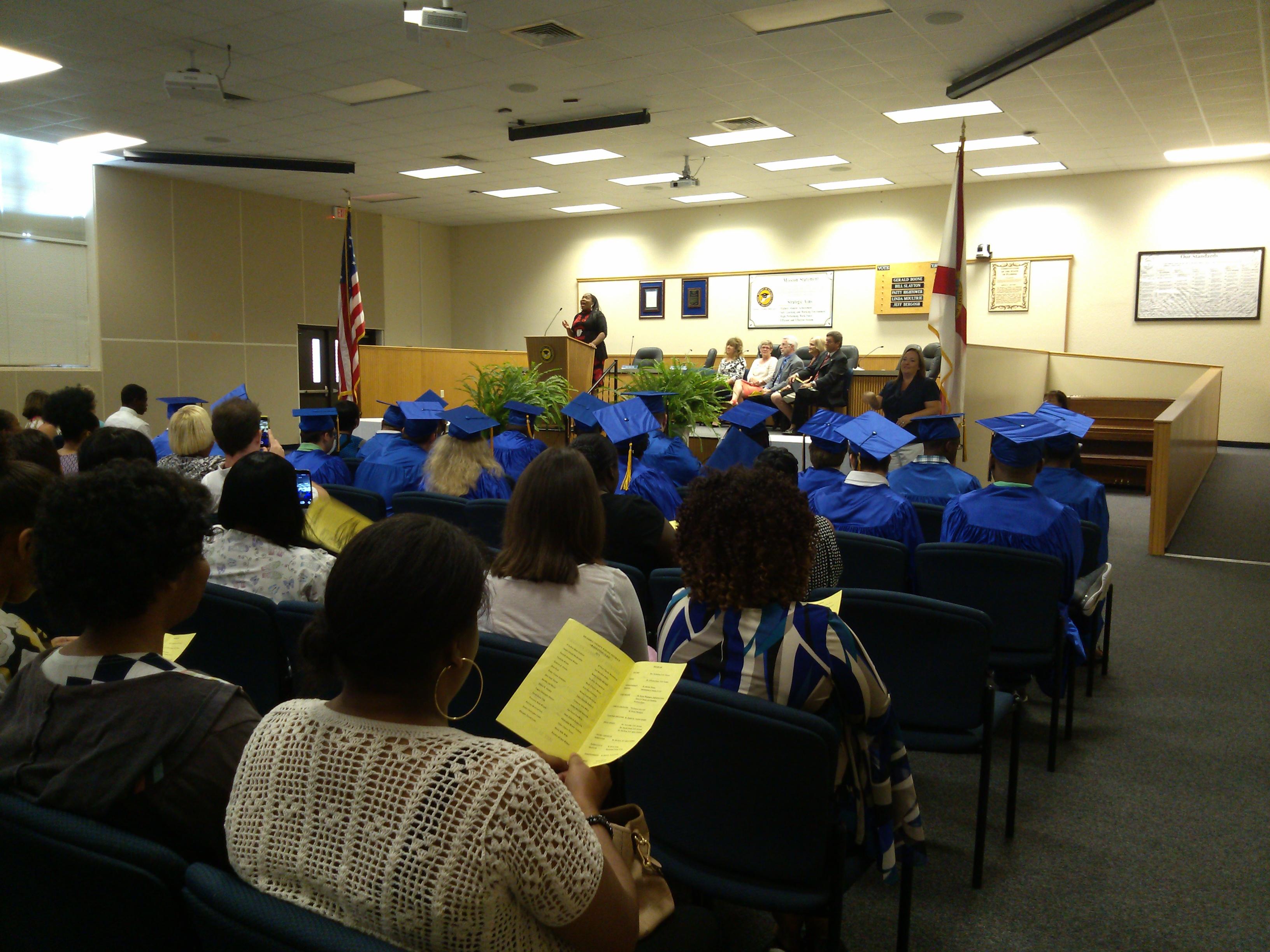 Katrina Washington singing at the Escambia County School District Graduation ceremony.