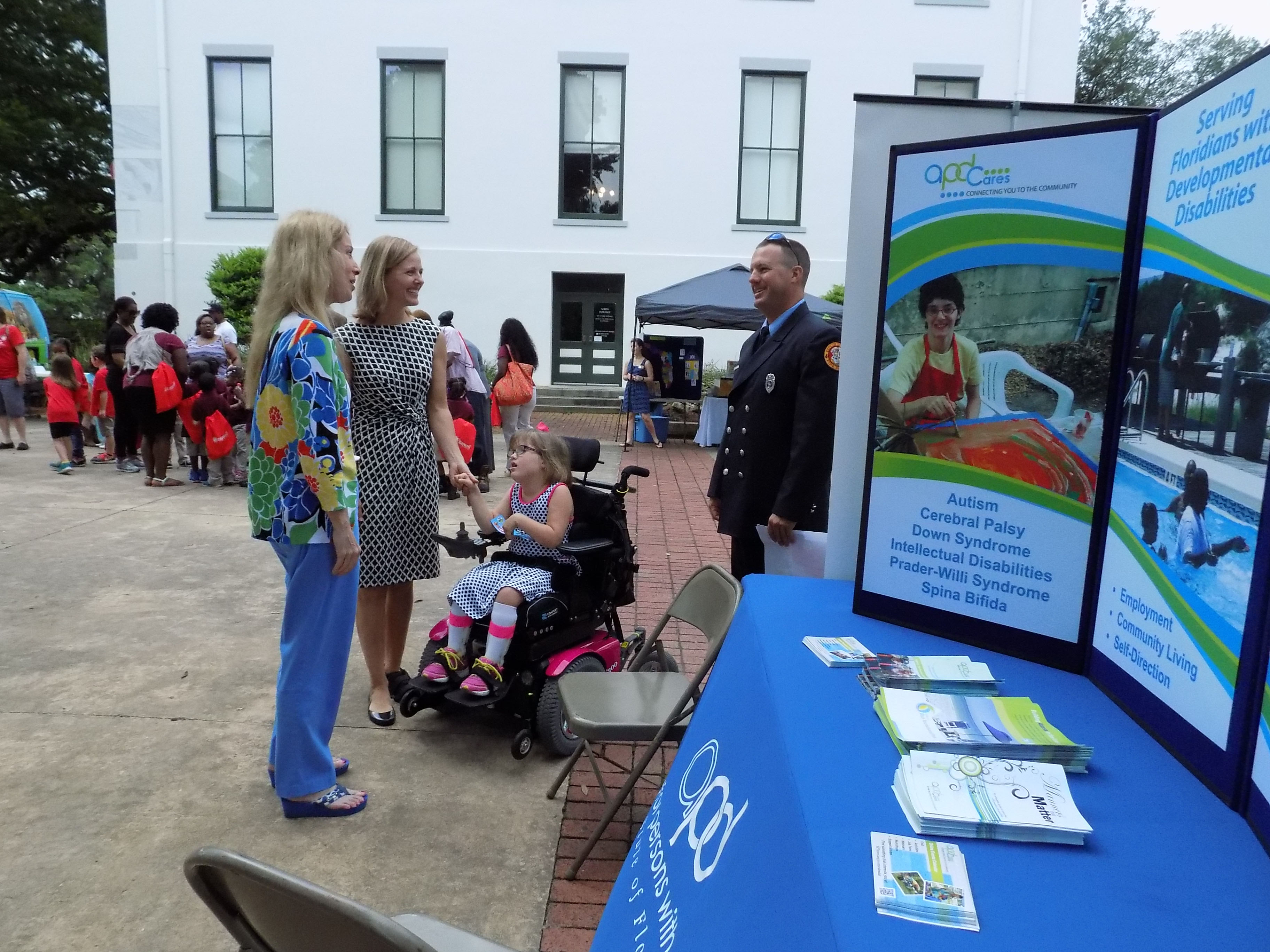 Melanie Etters helps a family at the APD exhibit table.