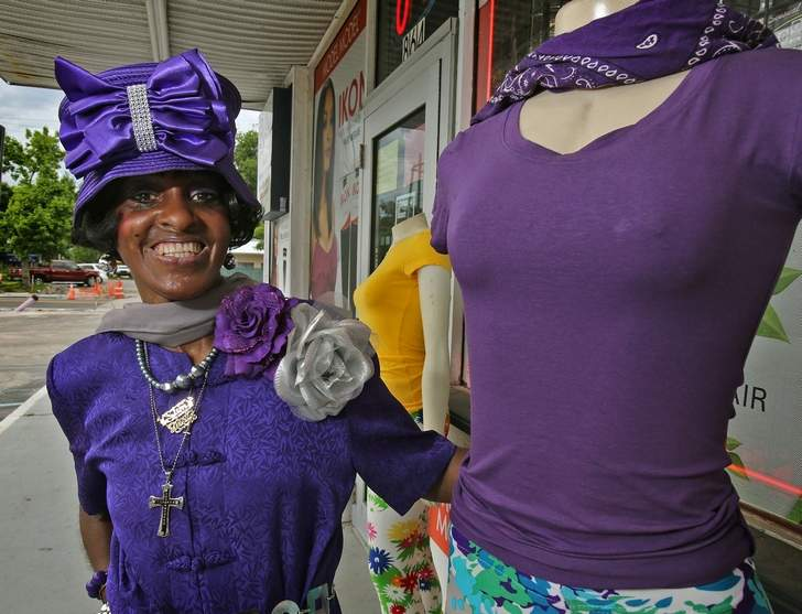 Mildretta Williams of Daytona Beach and a mannequin wear purple in observance of World Lupus Day. She is dressing mannequins to break into the fashion business.  Photo courtesy of the Daytona Beach News-Journal.