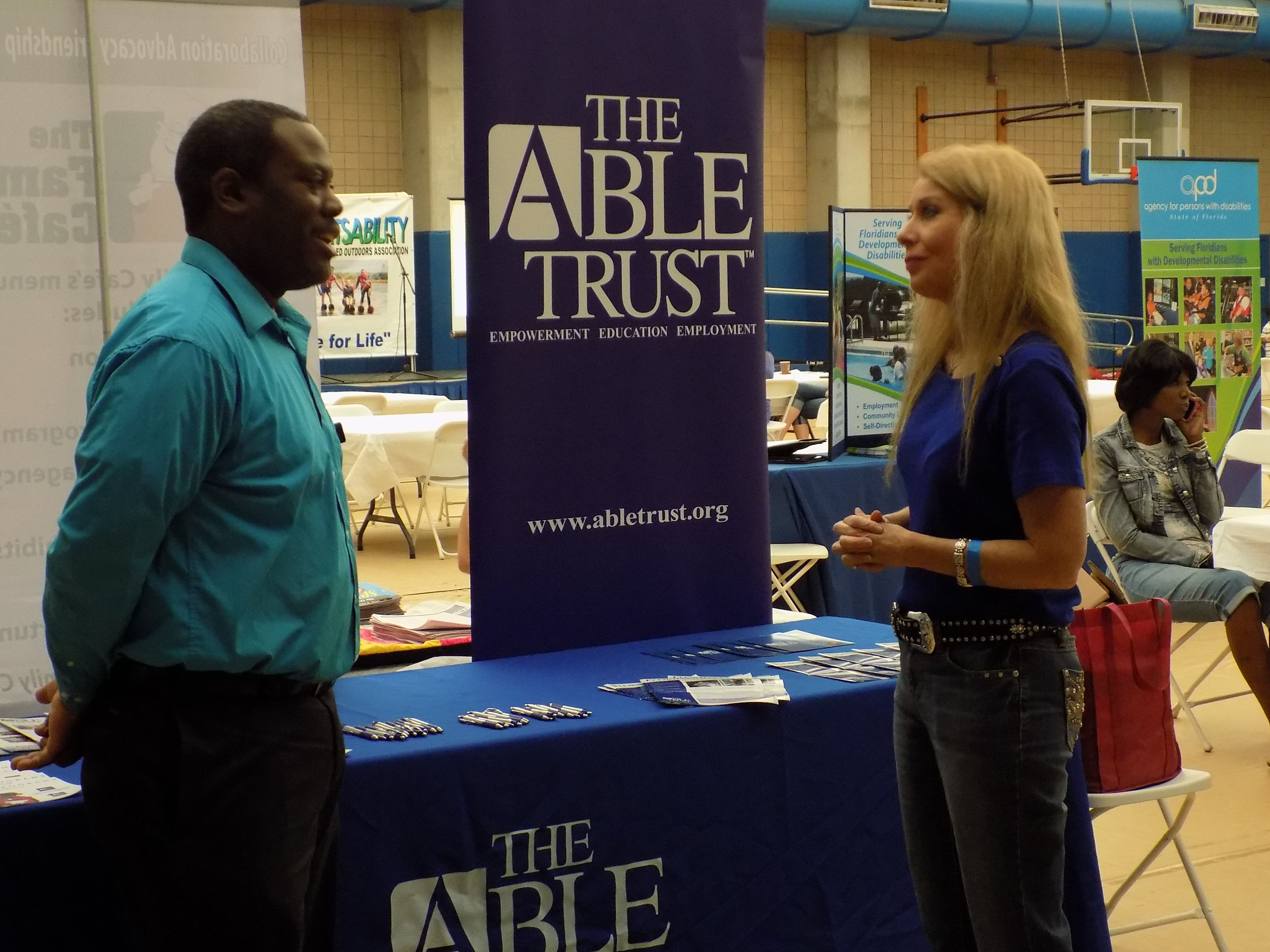 APD Communications Director Melanie Etters visits Ray Ford of The Able Trust.