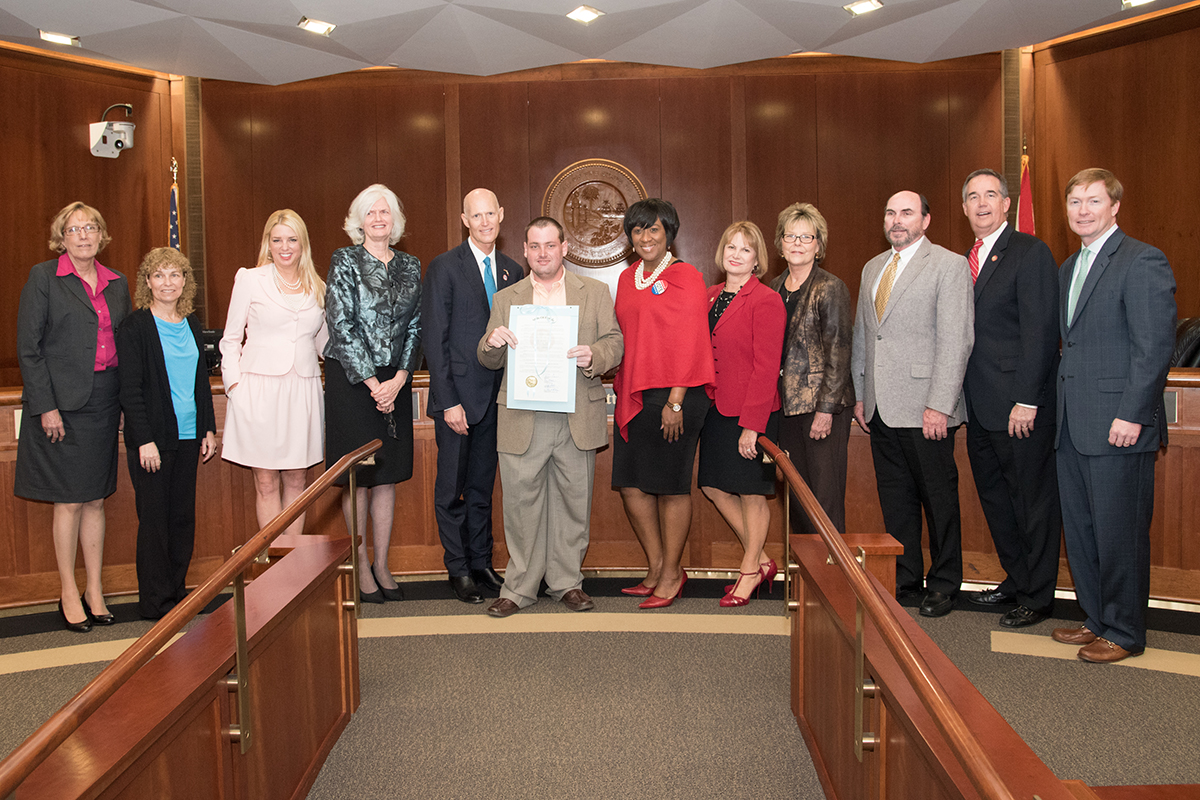David Poepping Holds The Proclamation Declaring March As Developmental  Disabilities Awareness Month For A Group Picture With Florida Cabinet  Members.